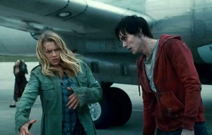 Julie and R the zombie from Warm Bodies prepare to shuffle through a crowd of the undead.