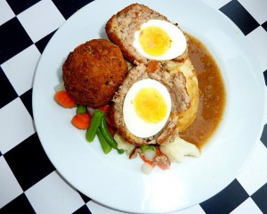 Whereas the Manchester egg uses a pickled egg wrapped in a mixture of pork meat and Lancashire black pudding